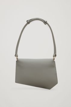 COS image 2 of Folded rubberised leather bag in Dark Sage