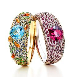 Left: Bracelet with a 21.04-carat round aquamarine in a sea of mixed-cut gemstones, including spessartites, tsavorites, sapphires and diamonds with an underlay of aquamarines in 18 karat yellow and white gold. Right: Bracelet with a 32.05-carat cushion-cut rubellite and an underlay of pink sapphires, with diamonds and 18 karat white gold in a coral motif.