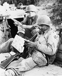 Private John Harvey, left, of 1758 East 32nd street, New York City, and Pfc. Jose Pena Reyes, of 3510 Oro street, El Paso, Texas, members of an American 5th Army infantry regiment, take time out to read the funnies just before attacking Santa Maria Infante, Italy. John and Jose had their laugh at the antics of Blondie and other Sunday morning favorites—then went on and helped take the town - pin by Paolo Marzioli