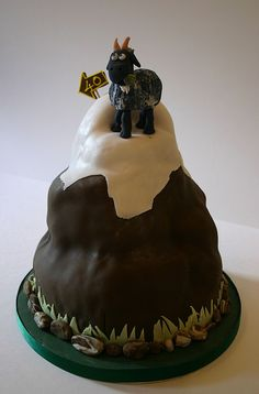 How did I just get talked into making a grooms cake?!      Mountain Goat Cake- possible inspiration...
