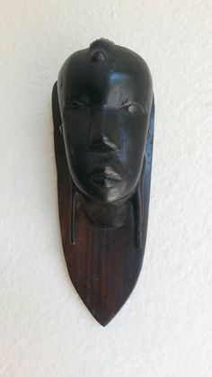 Check out this item in my Etsy shop https://www.etsy.com/listing/491252929/vintage-african-lady-face-wooden