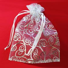 """50 Organza Gift Bags with high quality print, size 4.5""""x6"""".Our own customize line of Sheer Organza Pouch Bags is more than elegant. The bags are made of high quality sheer organza, with decorative silver or gold print. It gives the bag its see-through quality."""