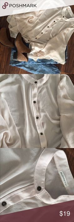 Audrey 3&1 Poncho-Style Top This is one of my favorites in my closet, but y'all are in luck because I have to downsize my closet! 😭 This Audrey 3&1 Cream Blouse Top is poncho-style and is super cute with black pants and boots! Love the button up detail. Fits oversized- Audrey 3&1 Tops Blouses