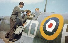 Ground crew assist a 222 Squadron Spitfire Vb pilot preparing for his next sortie at RAF North Weald