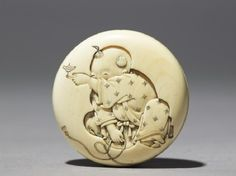Manjū netsuke with a boy playing with a spinning topfront //  Date     1831 - 1900 /   Artist/maker:      Kōrin (active c. 1831 - c. 1900)