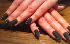 Black matte stiletto nails.