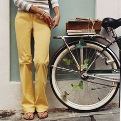 books tied with strings + yellow trousers + old schwinn= love.