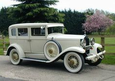 cream vintage car | It is finished in cream with beige cloth interior with ample room for ...