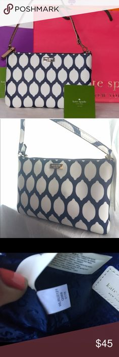 Lemon Print/Grant Street Grainy Vinyl Lolly Wrist KATE SPADE Lemon Print Grant Street Grainy Vinyl Lolly Wristlet Navy and white-8 x 5 x 1 in.  In excellent condition! Clean inside and out will fit iPhone 6S with case.- first photo was taken from google images.com kate spade Bags Clutches & Wristlets