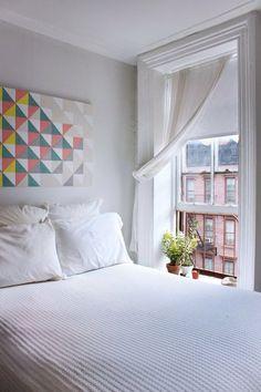 Small White Studio Bedroom with Geometric Art and Open Window