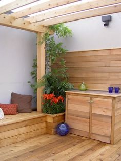 Rooftop retreat in downtown Toronto - built in benches, insulated planters, tiled cabinet and an amazing view
