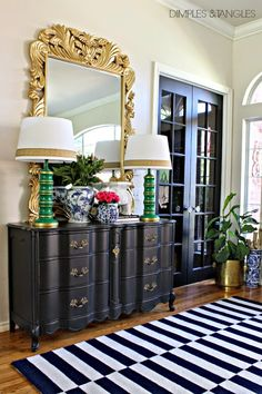 Colorful Entry, Foyer ||  Striped Rug  ||  Ornate Gold Mirror  ||  Black French Provincial Dresser for storage  ||  Blue and White  ||  Thrift Store Makeover Lamps