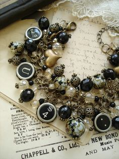 Typewriter Key Bracelet. Antiqued Brass, Black Jet, Champagne, Roses.