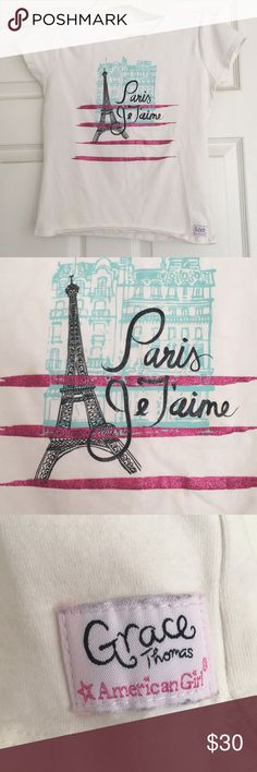 "AMERICAN GIRL GRACE'S PARIS JE T'AIME SHIRT AMERICAN GIRL GRACE'S PARIS JE T'AIME SHIRT Rarely worn. This white knit tee has a sparkly graphic on the front, including a drawing of the Eiffel Tower and the words Paris Je T'aime—meaning ""Paris, I love you."" Cotton/spandex. Imported. White. Bundle with Grace's city shorts from my closet to get 10% off your order! American Girl Shirts & Tops Tees - Short Sleeve"