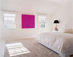 The pink light box in Alexandra von Fürstenberg's Los Angeles bedroom stands in stark contrast to the otherwise white bedroom, however, at night, the piece puts off a rosy glow, illuminating the otherwise Spartan room.