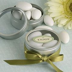 These silver tins can be decorated in any colored ribbon, such as gold seen here. They are prefect for filling with mints or candy and to give as wedding shower favors.