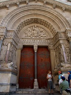 The west portal of the former cathedral on the place de la République. Built between the 12th century and the 15th century.  The West Portal is considered one of the treasures of Romanesque sculpture. The tympanum features Jesus surrounded by the sym Гид Барселона ! Трансфер Барселона ! Экскурсия в Барселоне #Испания #Барселона http://vipgid.wordpress.com/