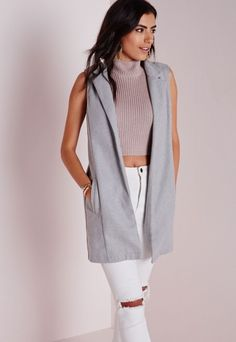 Get your style fix this season with this totally lust-have grey wool blazer. This sleeveless beaut screams get it or regret it with faux pockets to the front, and figure flattering fit this number is sure to turn heads. Style high over skin...