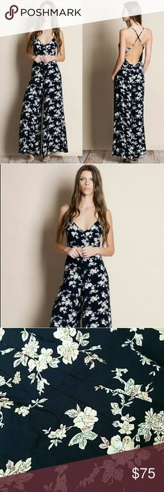 Floral Print Crossback Jumpsuit Floral print crossback jumpsuit  Navy background with watercolor flowers.  Modeling size small.  True to size Pants Jumpsuits & Rompers