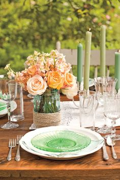 To re-create this whimsical centerpiece, cluster roses in a Mason jar. Wrap twine around the vase and hot-glue in place (or substitute heavy-duty double-faced tape). Make two or three to run down the center of the table, along with taper candles.