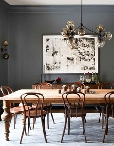 Love the charcoal color with the warm wood and golden colors