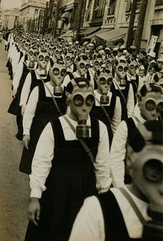 this is one of the most haunting pictures i have ever seen. schoolgirls in gas masks. WWII. Are you my mummy?