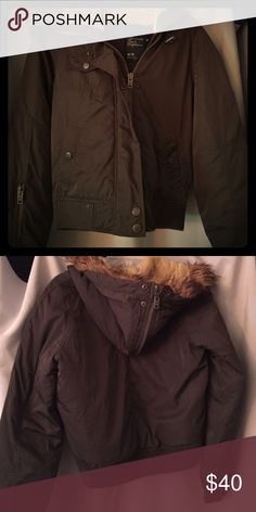 Olive green American Eagle winter jacket. Size medium American Eagle winter jacket. Olive green with functioning zipper, as well as zipper through the hood. Worn but it great condition. American Eagle Outfitters Jackets & Coats Puffers