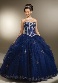 Strapless long royal blue evening dress with white floral rhinestone accents from Vizcaya By Mori Lee (Style: 87093).