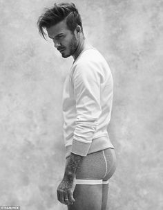 Bottoms up: David Beckham wows in the new H&M campaign wearing boxer shorts and a jumper