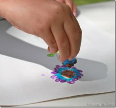 Fine motor skills (grip): painting with tiny sponges