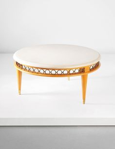 JEAN ROYÈRE Coffee table, circa 1948  Marble, cherry wood, brass. 46 cm (18 1/8 in.) high, 96 cm (37 3/4 in.) diameter
