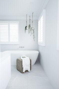 Three Birds Renovations House 6 #lanasforeverhome Caroma Contura Solid Surface Freestanding Bath #bathroominspo #santorinivibes #mediterranean #white #hangingplanters #bathroomdesign #bathroomreno #bathroomtiles #caroma #inspiringbathrooms