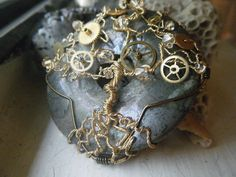 Steampunk Tree of Life Pendant -  Pyrite and Swarovski Crystals - Gold and Watch Gears - fool's gold - Whimsical. via Etsy.