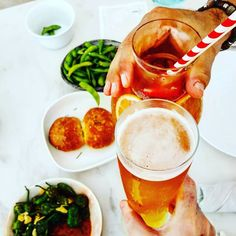 Cheers! Padron peppers and edamame acting as a perfect backdrop and starter for an Al fresco lunch @burjalarab
