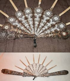 19C, probably 1840s-1860s, judging by the proportions.  Guard sticks:  19.6 cm long (8 inches).  There are no maker's  marks on this, so there's no telling where this was made;  though artisans in China and in the Middle East were highly skilled in filigree work.  There is no record of what the missing fan-leaf looked like or was made of.