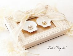"""Put a wedding ring that you can easily handcraft cute """"Shell ・ Gum . 簡単に可愛く手作りできる♡結婚指輪を置く「シェル・ガ… Images that are introduced in How to Make a Ring Pillow of """"Shell ・ Glass"""", where you can put on a wedding ring that can be easily handmade cutely Ring Holder Wedding, Ring Pillow Wedding, Wedding Ring Bands, Rustic Ring Bearers, Ring Bearer Box, Engagement Ring Platter, Engagement Rings, Main Image, Ring Pillows"""
