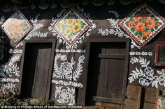Blooming lovely: Charming Polish village where housewives paint every home in flowers to cover smoke stains from stoves Each house in Zalipie, Poland, is decorated with its own floral motif Women used whitewash to cover up the soot marks left above stoves But marks still visible so they painted flowers on them, spreading outside Now there's a competition every year to find the best flower painter