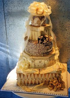 Golden Gifts  Tiered cake, decorated as stacked gift boxes. YES!