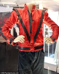 Iconic: The jacket Michael Jackson wore in his classic Thriller video has sold at auction for $1.8million USD (£1.1m)