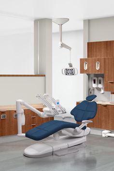 A-dec dental chair with Diplomat Blue upholstery and A-dec 500 dental equipment.
