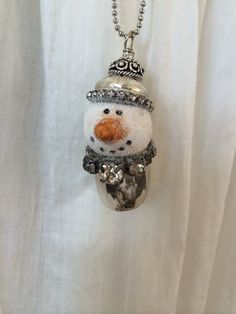 I have hand sculpted the cute little snowman and placed him in a Sterling Silver vintage Salt Shaker. This necklace is so cute to wear! It is very cute layered with other necklaces or worn alone. The