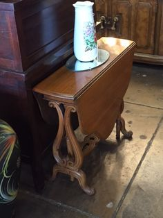 Super cute little narrow drop leaf table for entry.  No drawers, but lost of cute.