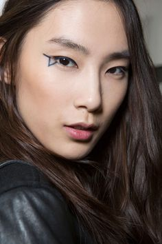 Anthony Vaccarello - HarpersBAZAAR.com Hair, makeup-- Bold eyeliner, natural hair *Selectively chooseing which feature to emphasize*