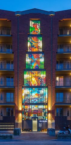 stefan glerum spans stained glass façade across amsterdam housing complex