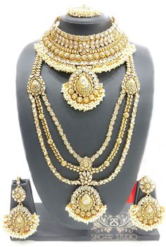 A Bridal Necklace Set that Makes You Feel Royal. The Color Complements All Outfits & May Be Worn as A Statement Piece for Any Extravagant Event or Festival...!!! #Sparkling #Kundan #polkijewellery #polkinecklace #necklace #desi #desibride #bollywoodjewelry #desijewelry #dubai #mumbaifashion #vamadesigns #gold #desibeautyblog #asiana #asian #dressyourface #instafashion #picoftheday #singarstudio #shoponline #gems #fashion #jewellery #bridaljewelry #bling #desibeautyblog #jewelsngems…