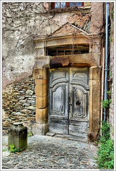 Wonderful old door in Conques, Aveyron, France. Just who has passed through there over the centuries?