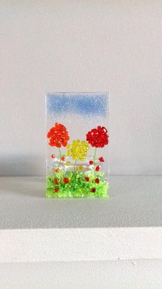 Fused Glass Flower Tea Light Holder  Gift Handmade Home Decor Mum Present  ||  A Beautiful fused glass Tea Light holder with colourful flowers. This Tea Light holder measures 10cm (h) x 6cm (w) x 5.5cm (d). Looks beautiful lit up making your room feel warm and cosy.  Includes a scented Tea Light candle.  Handmade in my home studio…