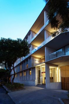 Residential Building With Unique Concrete Work + Modern Interiors Photo