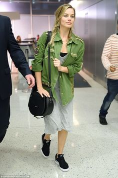 Casual chic: The 26-year-old actress opted for a long grey dress and a bright green jacket...