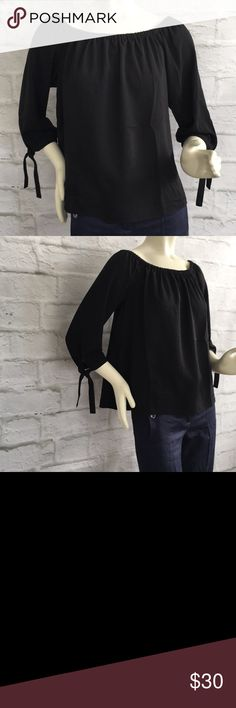 NWT J. Crew black off the shoulder top Blousy off the shoulder top. Fits loose with a tight fit to feel comfortable wearing it off the shoulder.  3/4 sleeves with a slit at the bottom with a tie. J. Crew Factory  Size:  Small Bust: 37in Length: 22 1/2 in Shoulder width: 17.5in  Material: 100% polyester J. Crew Factory Tops Blouses
